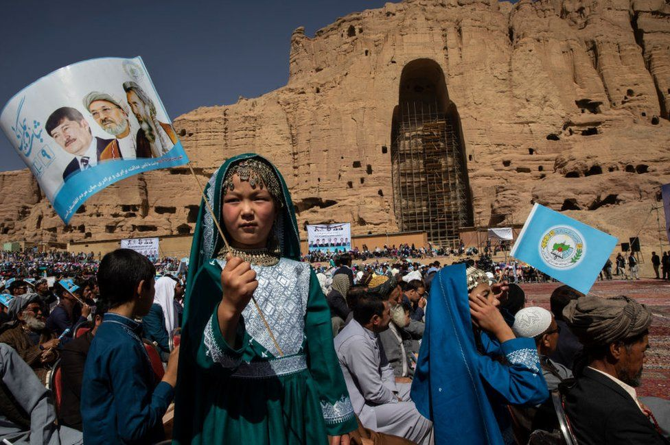 Afghans listen to speeches during the final campaign rally for presidential candiate Abdullah Abdullah in Bamiyan