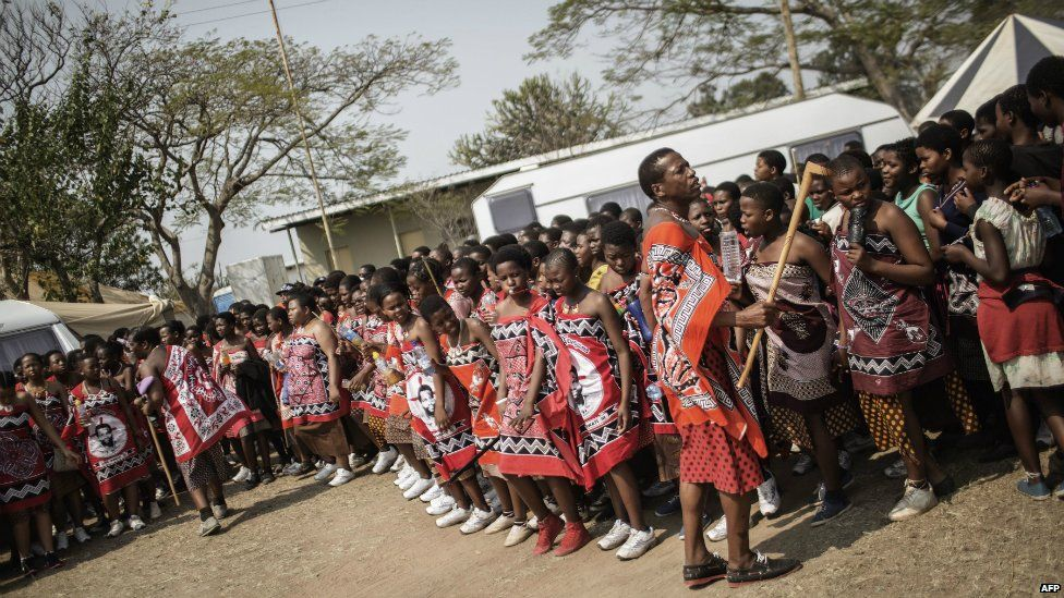 Swazi girls dance as they walk to the royal palace ahead of the traditional reed dance - 28 August 2015