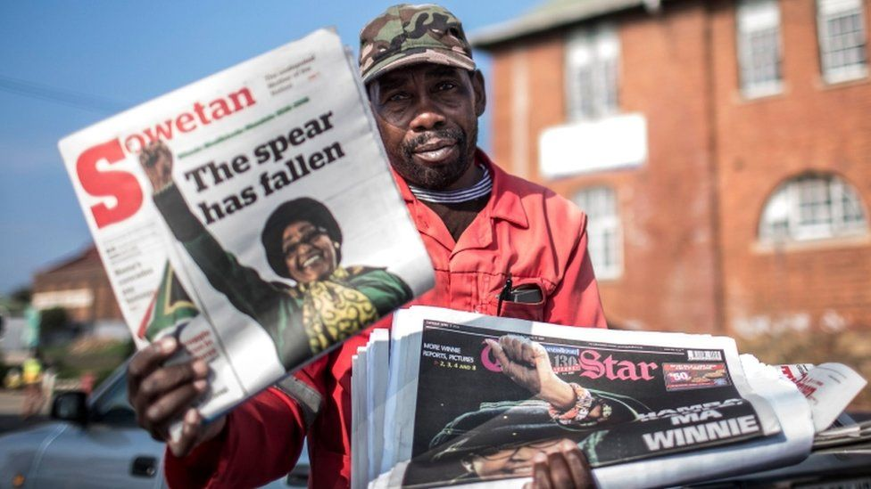 A newspapers vendor poses with newspapers, the day after death of South African anti-apartheid campaigner Winnie Madikizela-Mandela, in Johannesburg on April 3, 2018