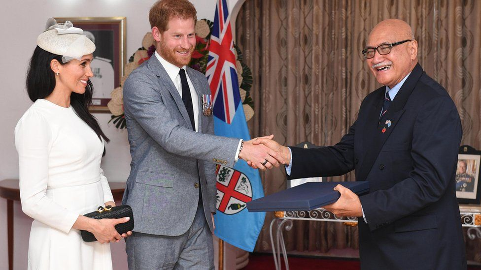 Meghan, Duchess of Sussex and Prince Harry, Duke of Sussex present a gift to the President of Fiji Jioji Konrote