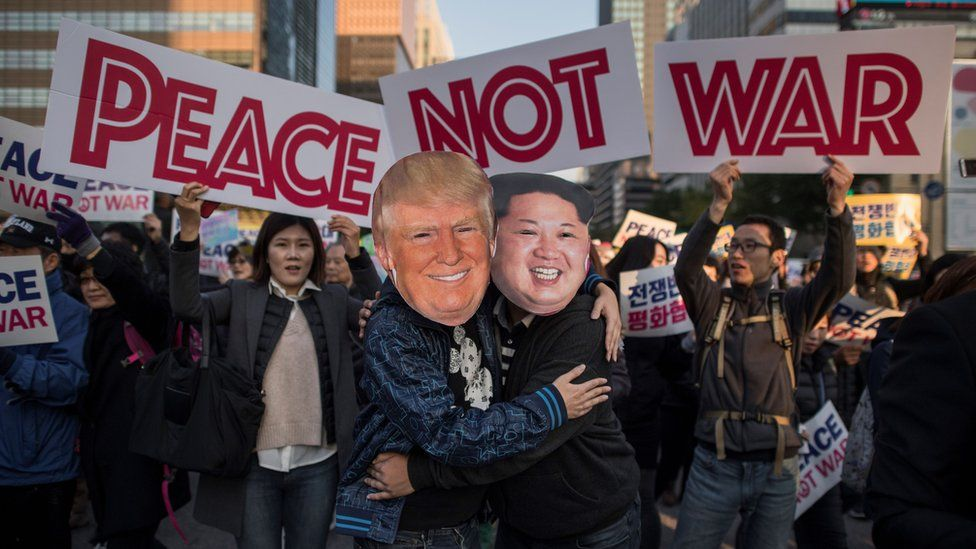 Demonstrators dressed as North Korean leader Kim Jong-Un (R) and US President Donald Trump (L) embrace during a peace rally in Seoul on November 5, 2017