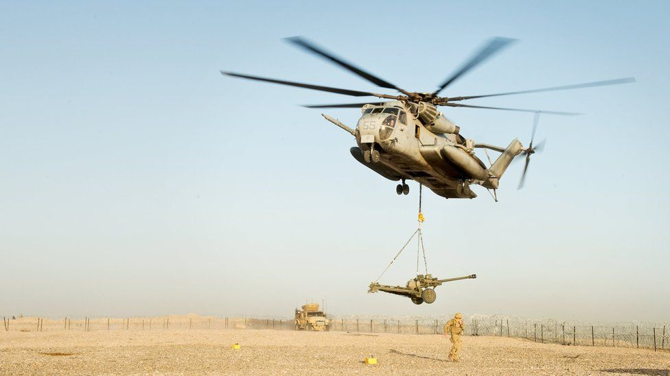 An artillery gun is air lifted out of a British base in Afghanistan by an American helicopter as the base is closed. 8 May 2014.