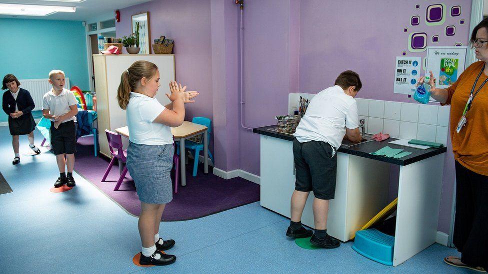 Children wash their hands at school
