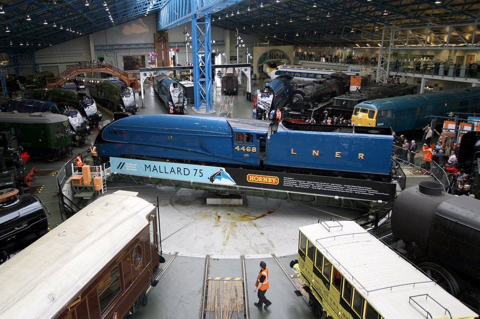 Visitors look on at the steam locomotives on display at the National Railway Museum on July 3, 2013 in York