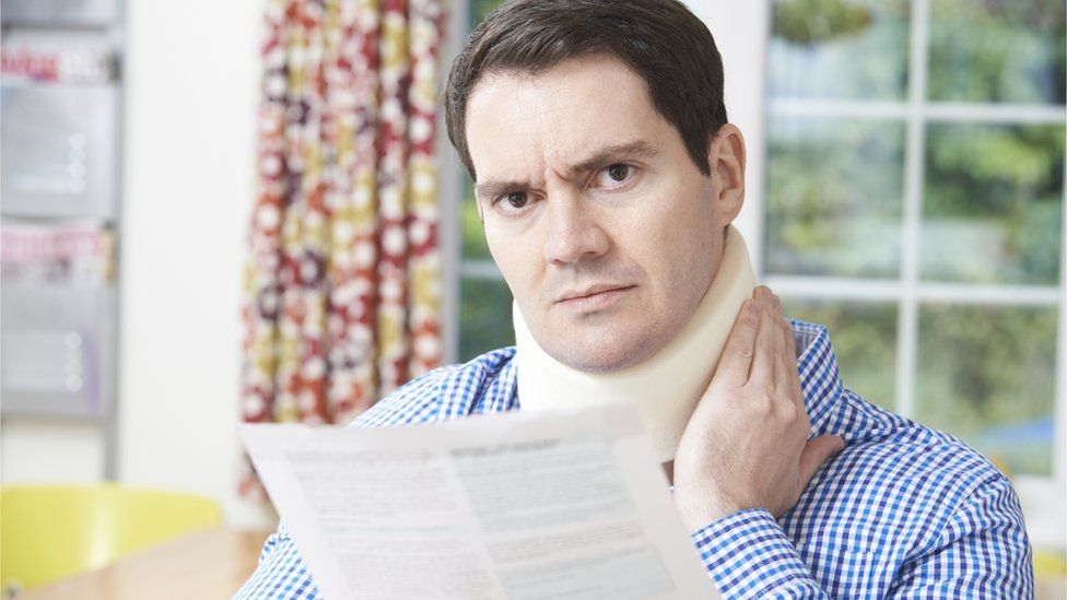 Man with neck injury reading letter