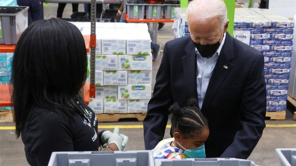He also received a hug from a young girl at the Houston food bank