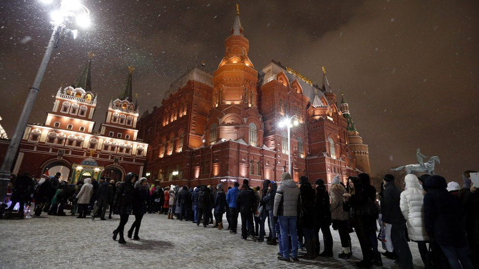 People stand in line for police checks at enter to the Red Square, Moscow, Russia 30 December 2015.