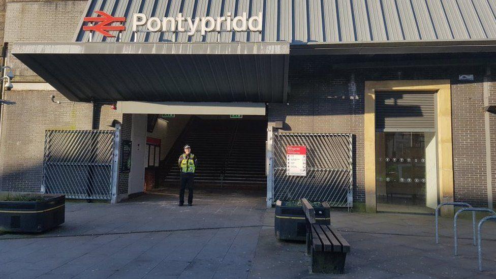 police officer standing outside Pontypridd station