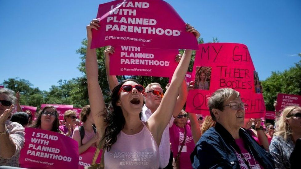 Claire Contreras, 30, reacts during a Planned Parenthood rally outside the State Capitol in Austin, Texas.