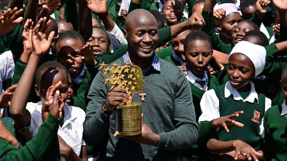 Peter Tabichi with pupils and his award