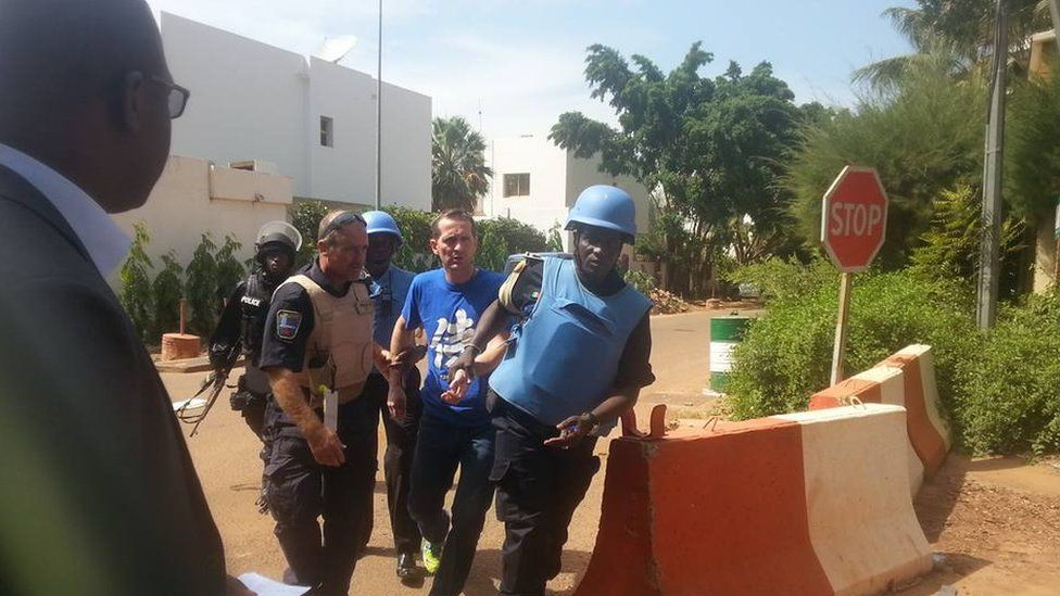 People being evacuated from Radisson Blu Hotel hotel in Bamako, Mali, Friday Nov. 20, 2015.