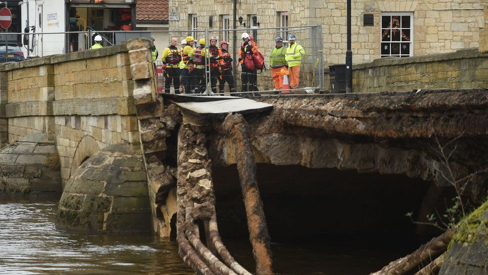 Emergency services by the collapsed bridge in Tadcaster, North Yorkshire