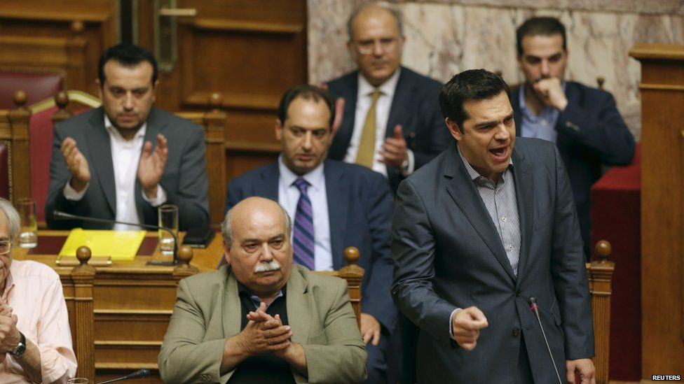 Greek Prime Minister Alexis Tsipras (front, R) is applauded in parliament on 11 July