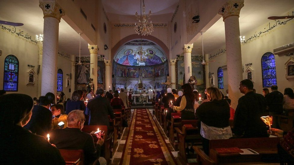 Palestinian Christians religious took part in a ceremony at Der Al-Latin Church in Gaza City