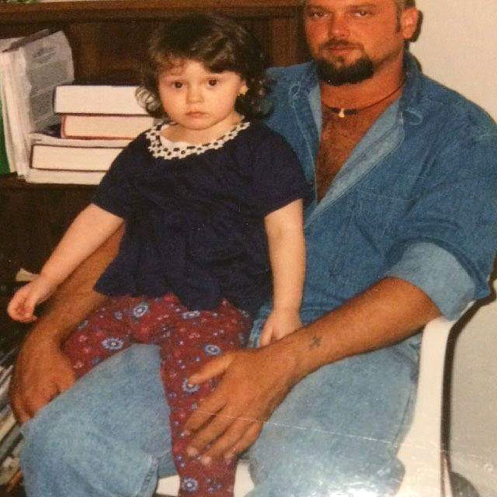 Rose on her father's knee