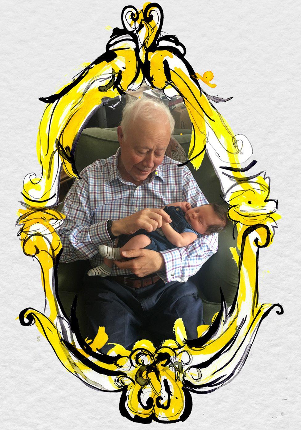 John Marriott cuddling his first grandson, Ollie
