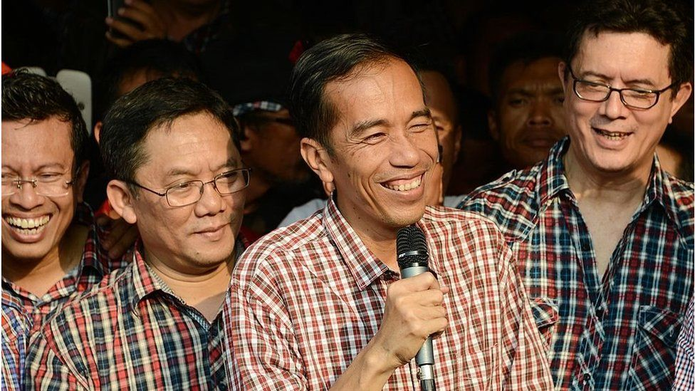 Governor elect Joko Widodo (centre, with microphone) delivers a speech in Jakarta on September 20, 2012.