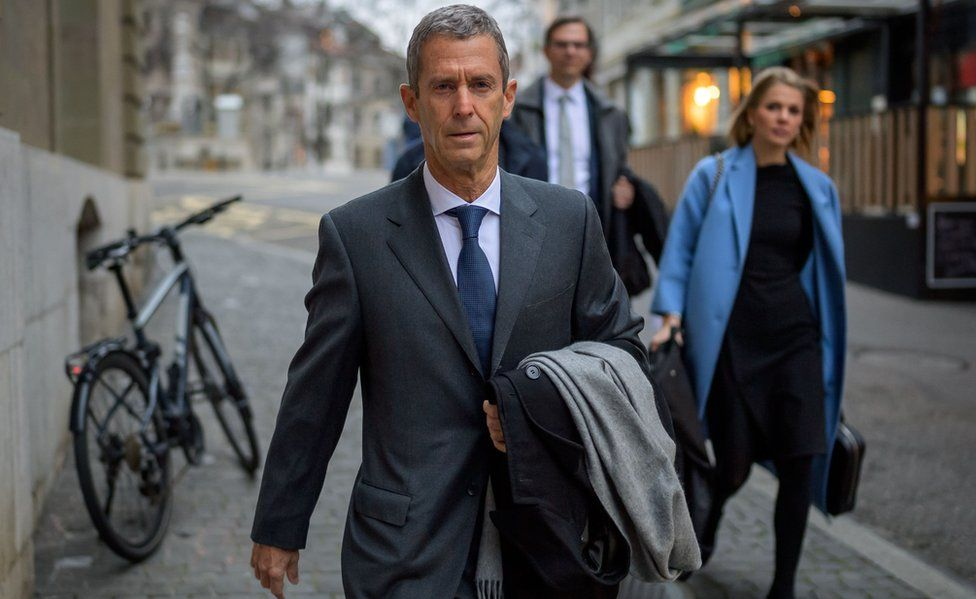 French-Israeli diamond magnate Beny Steinmetz (L) arrives with his lawyers at his trial over alleged corruption linked to mining deals in Guinea on January 11, 2021 in Geneva