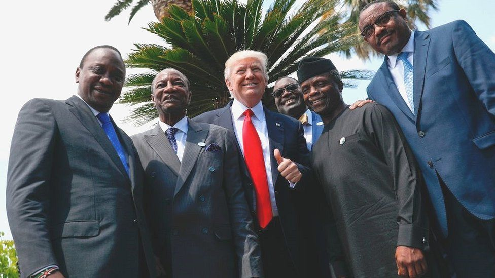 Donald Trump posing with African leaders in Italy