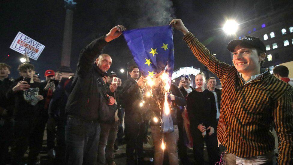 Pro-Brexit supporters burn a EU flag near to Trafalgar Square