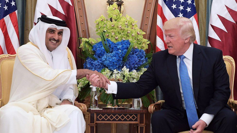 This file photo taken on May 21, 2017 shows US President Donald Trump (R) shaking hands with Qatar's Emir Sheikh Tamim Bin Hamad Al-Thani, during a bilateral meeting at a hotel in the Saudi capital Riyadh