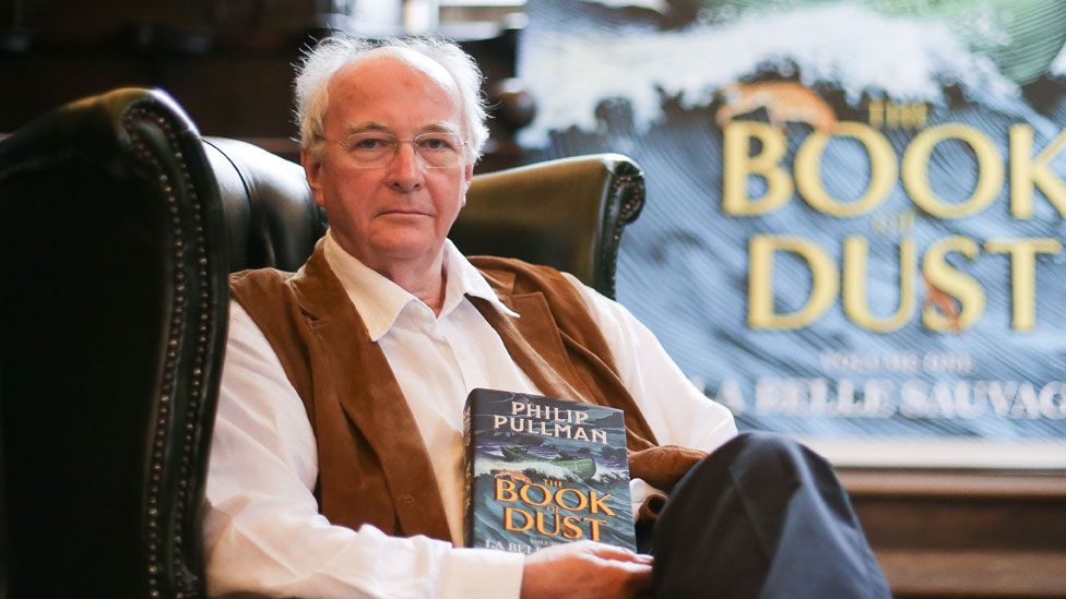 British author Philip Pullman poses with a copy of La Belle Sauvage: The Book of Dust Volume One in, 2017
