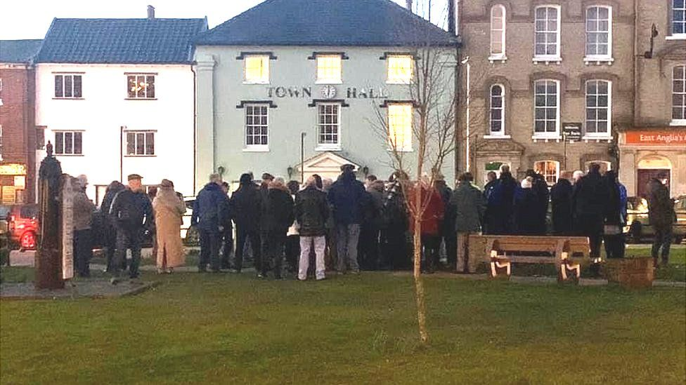 Crowd gathered in a town centre