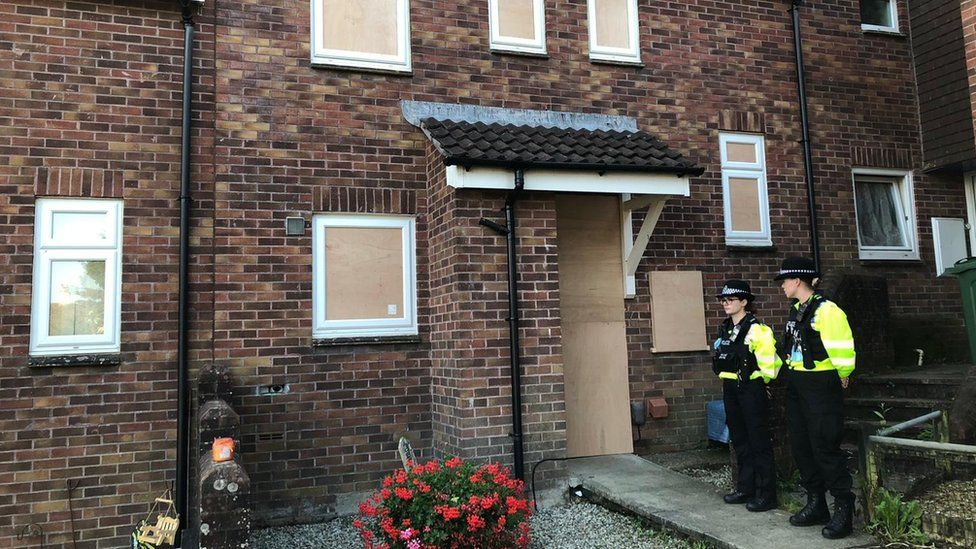 Police officers outside 17 Biddick Drive