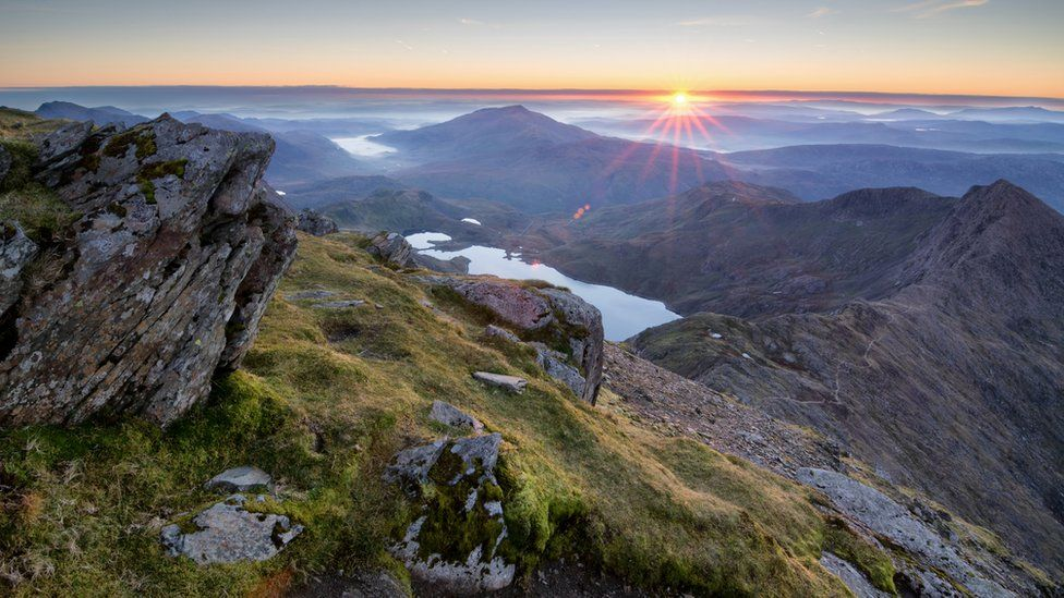 Sunrise over the Snowdonia national park as view from the summit of Snowdon