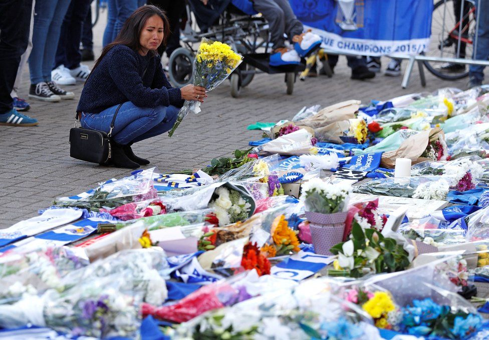 Leicester City football fans pay their respects outside the football stadium, after the helicopter of the club owner Thai businessman Vichai Srivaddhanaprabha crashed when leaving the ground on Saturday evening after the match, in Leicester, Britain, October 28, 2018
