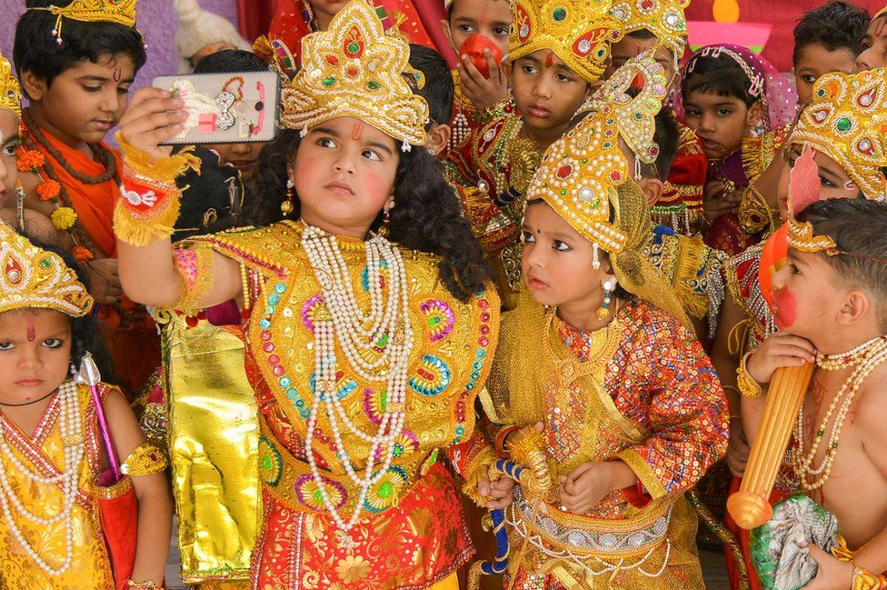 Indian children dressed up as the Hindu deities Rama and Sita take a selfie photograph at an event to celebrate the Diwali festival in Ajmer in western Rajasthan state, 6 November 2018.