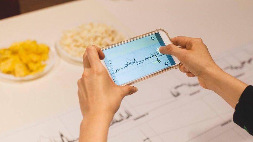 Citizen with smart phone showing noise vibrations