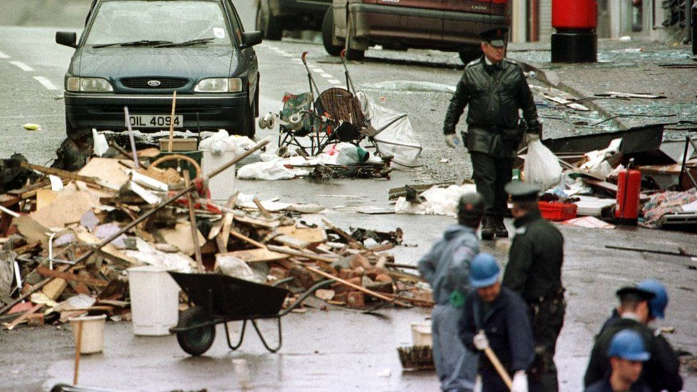 RUC and forensic officers sift through the debris of the Omagh explosion