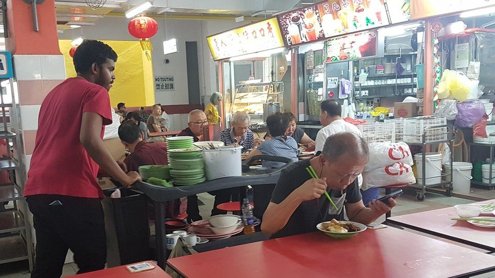 Cleaner in hawker centre