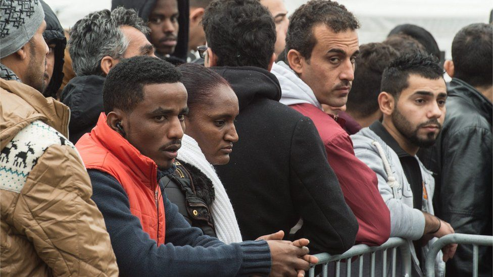 Recently arrived refugees wait for registration at the Hessian Initial Reception Center (HEAE) in Giessen, Germany, 02 December 2015.