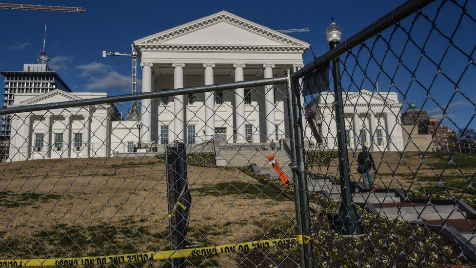 Fencing surrounds the front of the Virginia State House in Richmond,