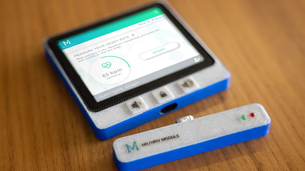 A device with a heart rate monitor displayed on a screen and a detacable sensor is seen