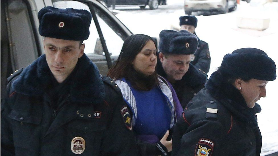 Gyulchehra Bobokulova (C) escorted by police arrives to the Presnensky district court in Moscow, Russia, 02 March 2016