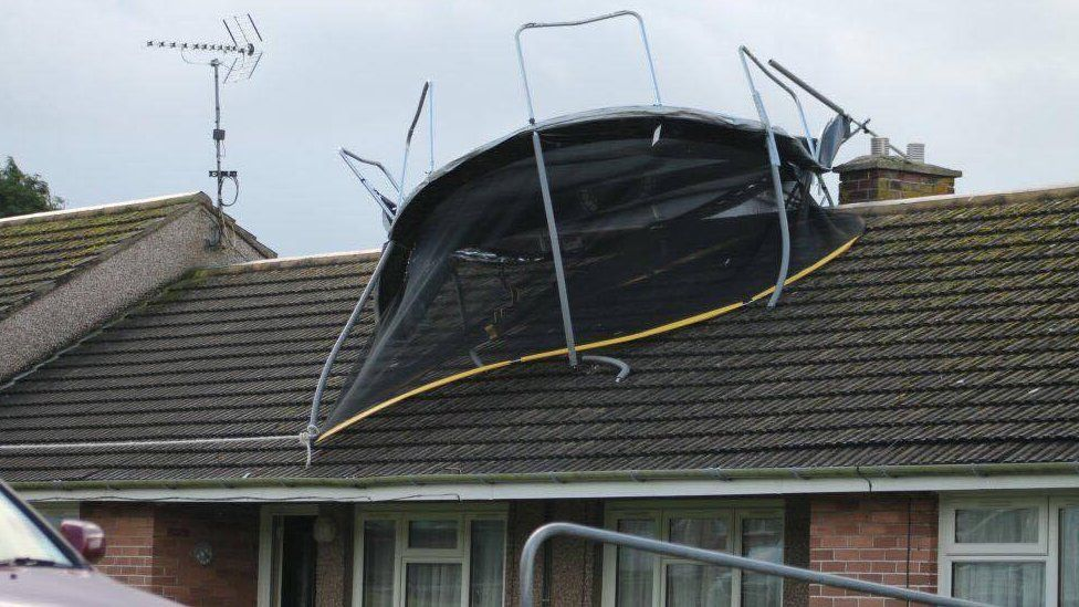 Trampoline on house roof at Cardigan