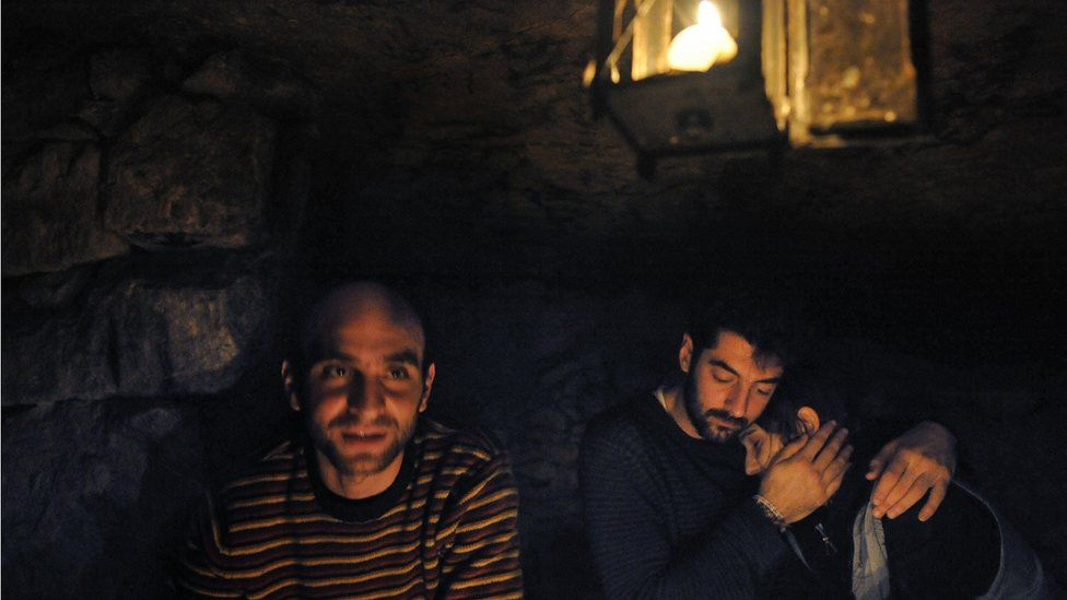 A group of cataphiles sit in the tunnels below Paris in 2008