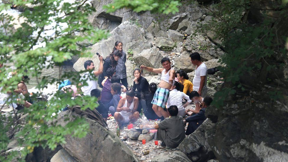 People picnicking in a part