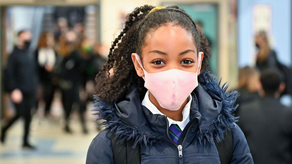 A secondary pupil at Rosshall Academy in Glasgow wearing a pink face mask