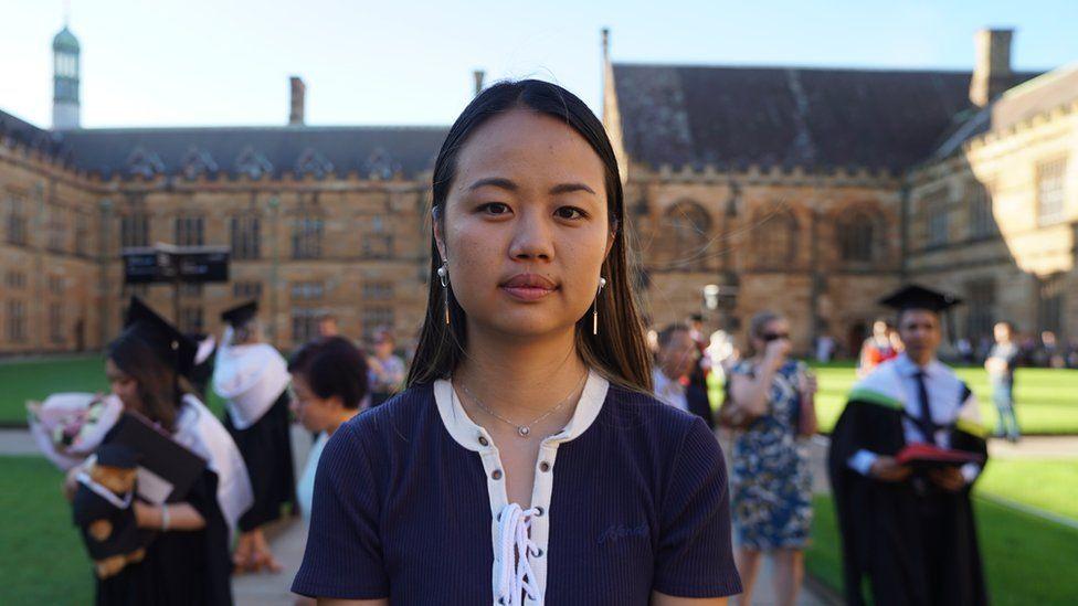 Liliana Tai in front of university graduates at the University of Sydney