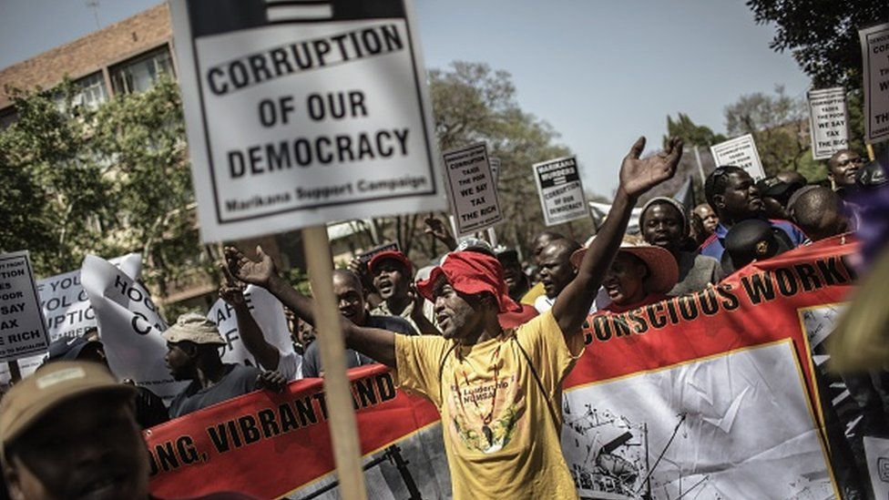 An anti-corruption activist shouts political slogans on 30 September 2015 in Pretoria, as thousands of protesters march to the Union Buildings, during a demonstration against corruption organized by various South African unions and political and civil societies.