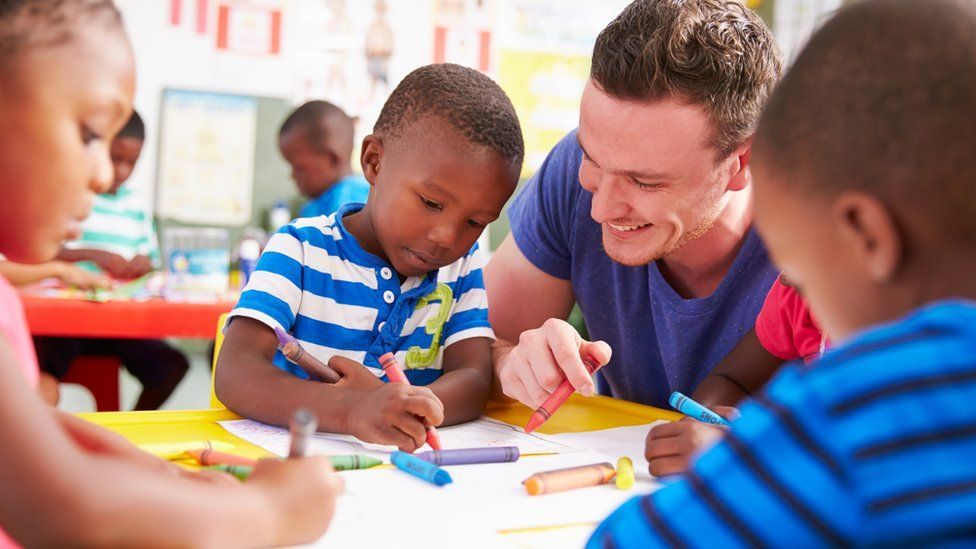 A man with pre-school children