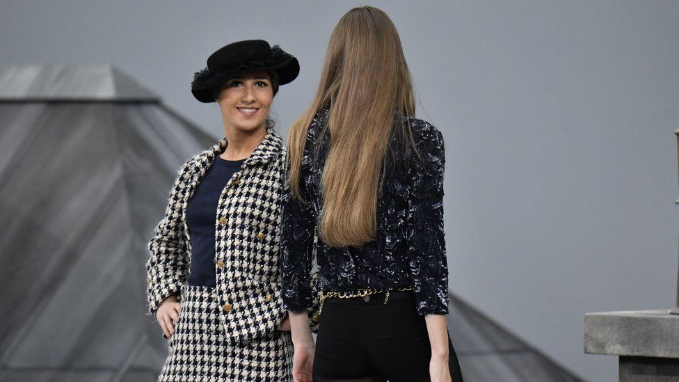 Marie S'Infiltre on the runway and the back of model Gigi Hadid