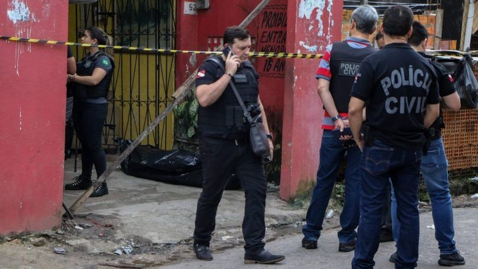 Police officers are seen outside a bar after a shooting, in Belem, Para state, Brazil on May 19, 2019.