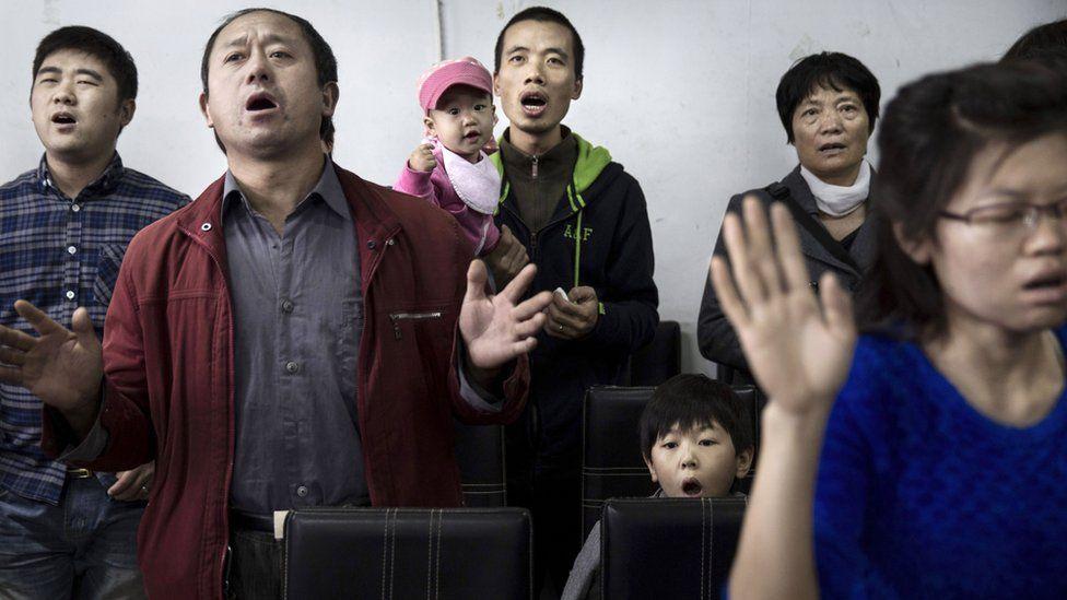 Protestants pray at an underground church