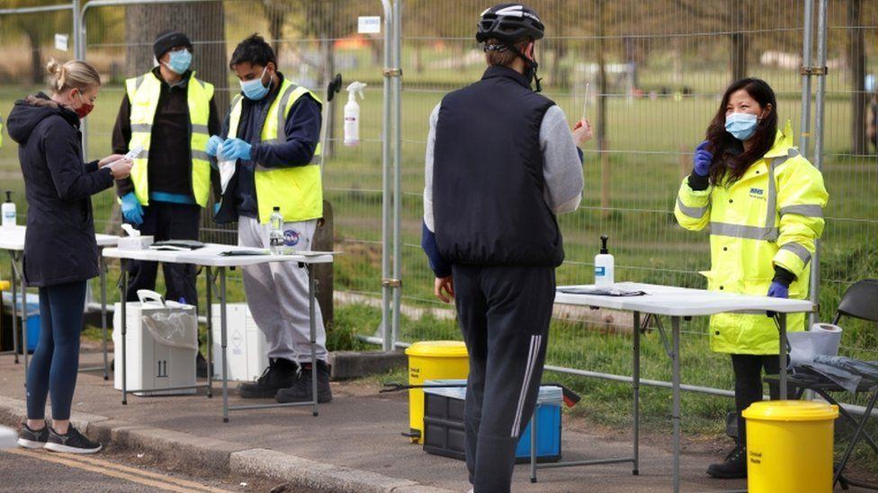 People take coronavirus tests on Clapham Common in London