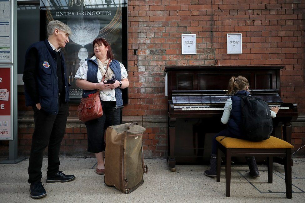 Malcolm Ingram, Jill Robinson and her daughter Katie Robinson at the Darlington piano